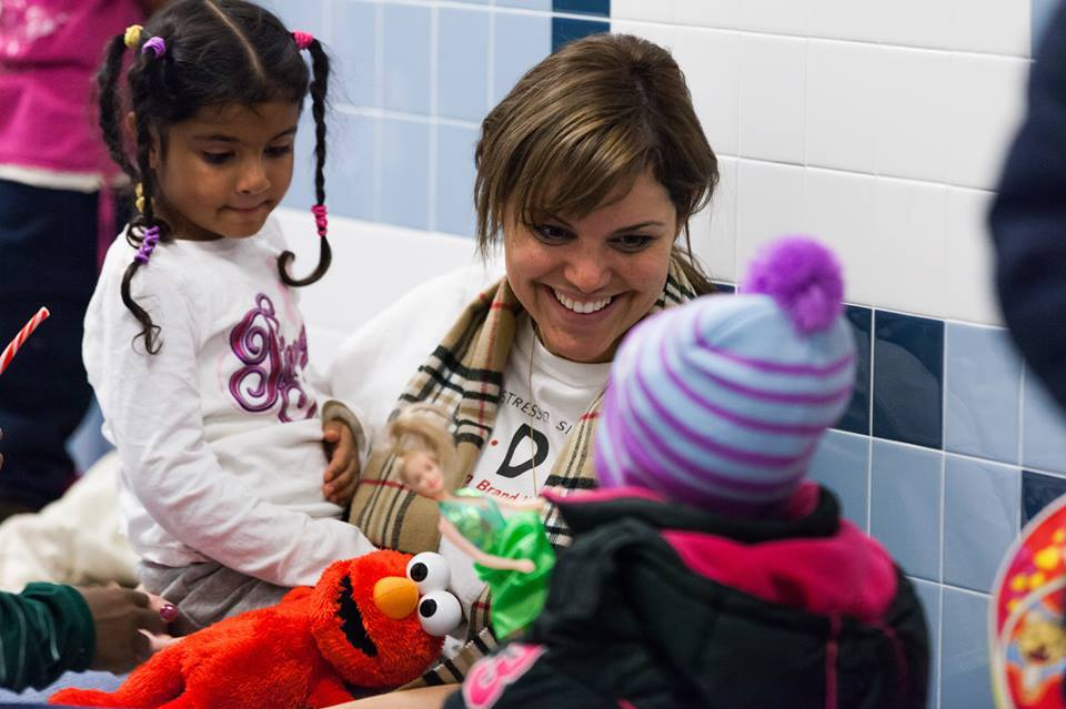 K.I.D.S. Director of Development, Cristina Morais, has a moment with some little ones at the recent K.I.D.S. Pop Up Shop in the Far Rockaways